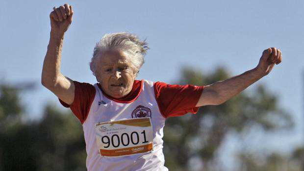 Canada's Olga Kotelko competes in the women's long jump during the Masters Games in Sydney Oct. 16, 2009.
