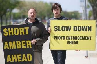 JOE BRYKSA / WINNIPEG FREE PRESS WiseupWinnipeg leaders Todd Dube, left, and Chris Sweryde holding signs on the roadside in Winnipeg-May 30 , 2016.(see Gordon Sinclair story)